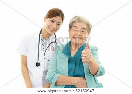 Smiling Asian medical doctor and senior woman