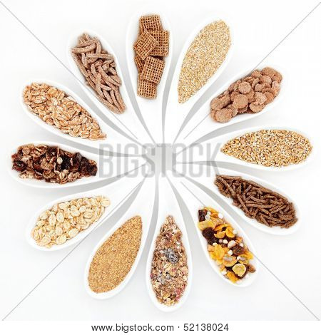 Healthy breakfast cereal selection in porcelain dishes over white background.