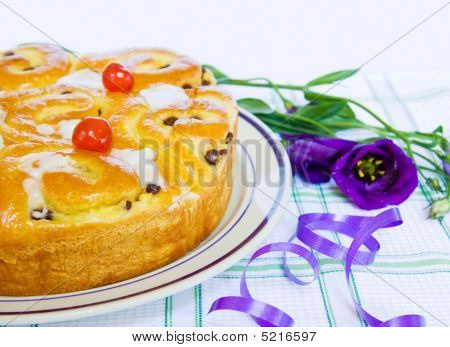 Celebration Baked Cake With Iris Flower And Purple Ribbons
