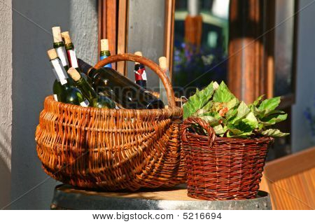 Baskets With Bottles Of Wine And Salads