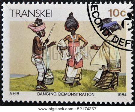 Republic Of South Africa - Circa 1984: A Stamp Printed In Transkei Shows Dancing Demonstration