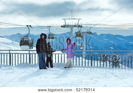 Family On Ski Station Top And Snowfall (molltaler Gletscher, Austria).