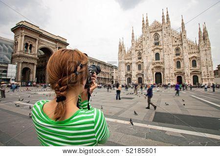 Woman taking picture of Duomo di Milano, Italy