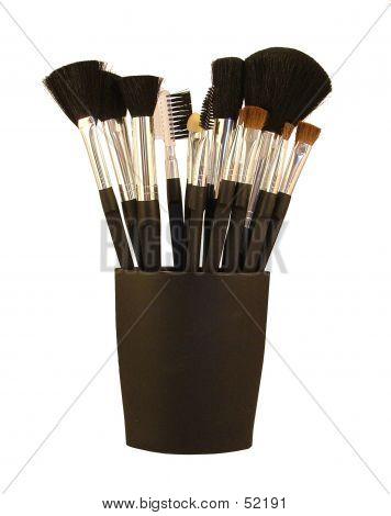 A Set Of Make Up Brushes In A Black Holder