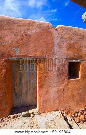 Ibiza grunge orange facade in Benirras beach at Balearic Islands Spain