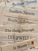 LONDON UK - SEPTEMBER 21: Major international newspapers headers on September 21 2013 in London UK poster