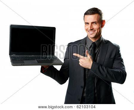 Happy businessman standing with laptop and showing on it isolated on a white background