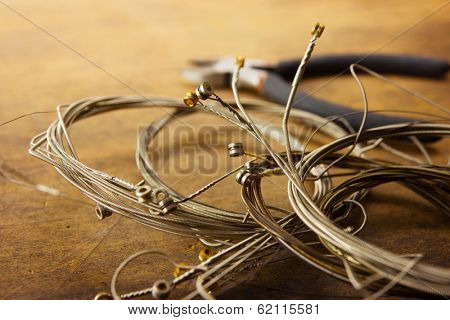 Old guitar strings, isolated on white, old guitar strings, coiled and bundled.