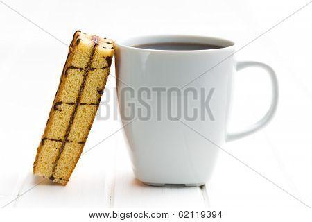 the coffee mug and sweet dessert