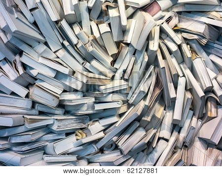 many books are completely messed up on a pile