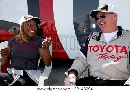 LOS ANGELES - MAR 15:  Carmelita Jeter, Al Unser Jr at the Toyota Grand Prix of Long Beach Pro-Celebrity Race Training at Willow Springs International Speedway on March 15, 2014 in Rosamond, CA