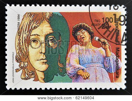 stamp printed in Madagascar shows John Lennon (1940-1980) Ella Fitzgerald (1917-1996)