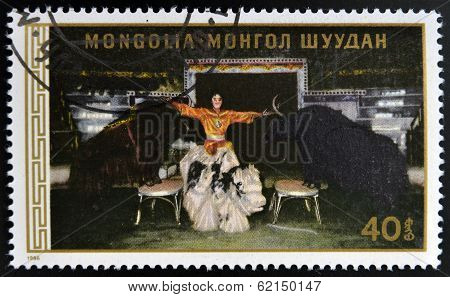 A stamp printed in Mongolia shows Man with bulls