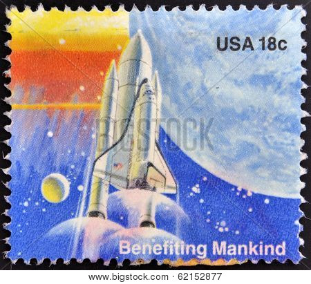 A stamp printed in the USA shows Benefiting Mankind