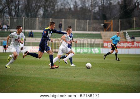 KAPOSVAR, HUNGARY - MARCH 16: Florean Andrei-Alexandru  (white) in action at a Hungarian Championship soccer game - Kaposvar (white) vs Puskas Akademia (blue) on March 16, 2014 in Kaposvar, Hungary.