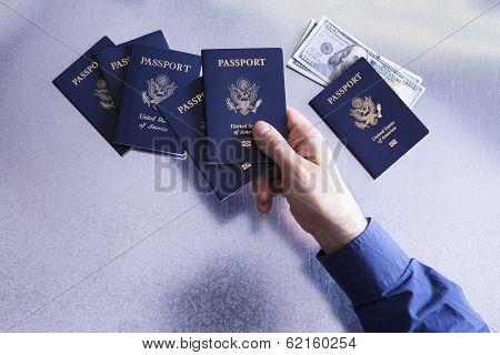 Man Sorting And Checking Us Passports