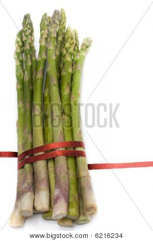 Asparagus with ribbon isolated on white