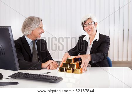 Businesswoman With Gold Bullion Bars