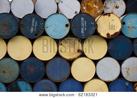 stack of old fuel tanks background texture poster