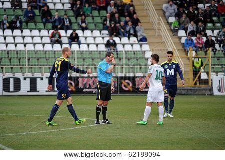 KAPOSVAR, HUNGARY - MARCH 16: Peter Solymosi (referee) in action at a Hungarian Championship soccer game - Kaposvar (white) vs Puskas Akademia (blue) on March 16, 2014 in Kaposvar, Hungary.