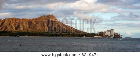 Diamond head With Surfers And Paddle Boarders