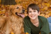 Teenager with Golden Retriever in the Fall poster