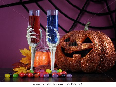 Happy Halloween Ghoulish Party Cocktail Drinks With Spider Web And Decorations On Purple Background.
