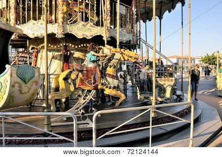 Carousel With Wooden Horses