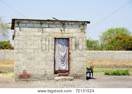Small Brick House in Poor Residential Area in African City