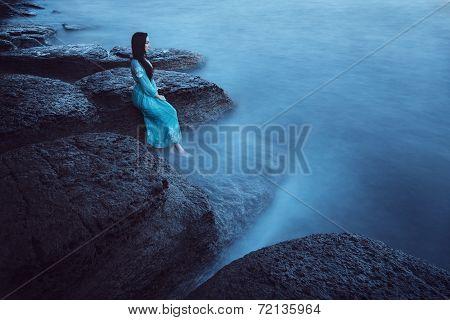Beautiful young woman on sea