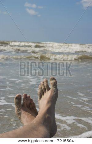 Feet sand ocean
