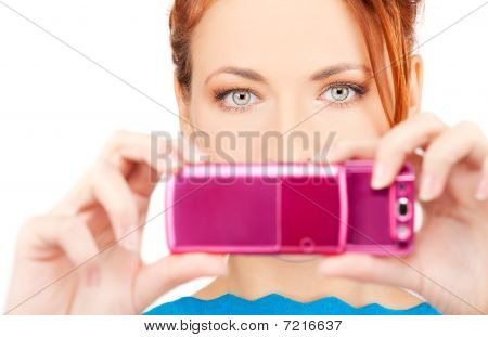 Redhead Woman Using Phone Camera