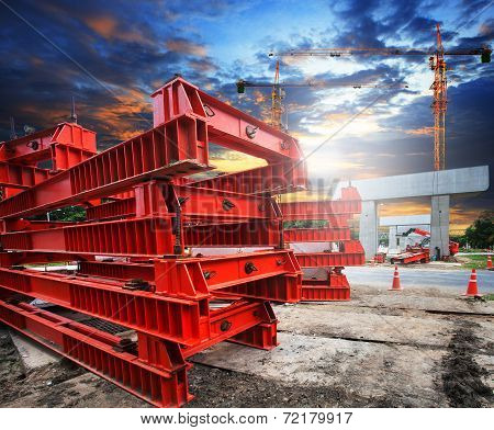Heavy Trains Bridge Crossing Highways In Construction With Part Of Big Crane Structure On Ground