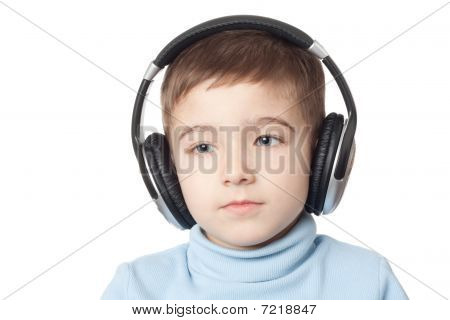 Thoughtful Boy In Headphones
