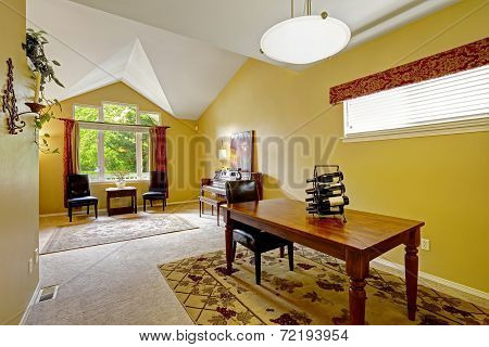 House Interior With Bright Yellow Walls And Vaulted Ceiling