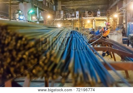 Worker in reinforcing shop