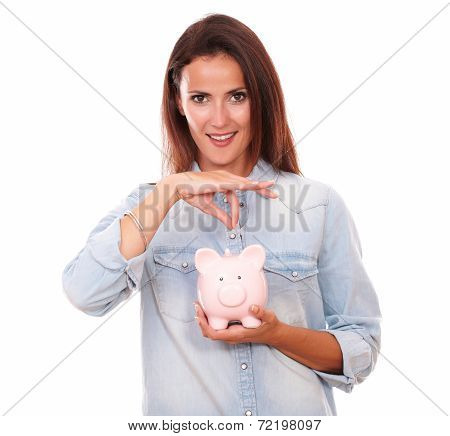 Friendly Hispanic Woman With Her Coin Bank