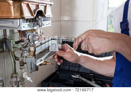 Handyman Adjusting Gas Water Heater