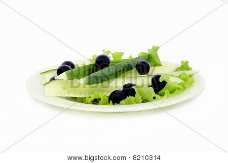 Cucumbers And Olives On A Dish