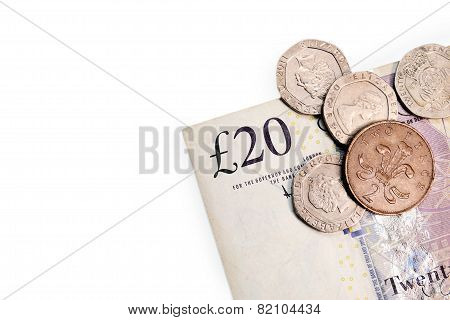 Twenty pounds and pence coins isolated on white