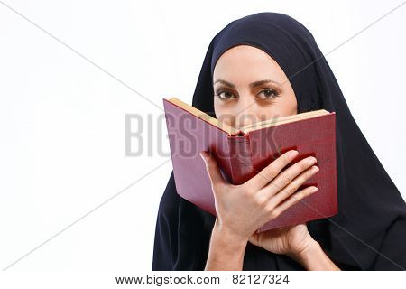 Beautiful Muslim woman holding a book