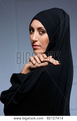 Beautiful muslim woman posing in chador