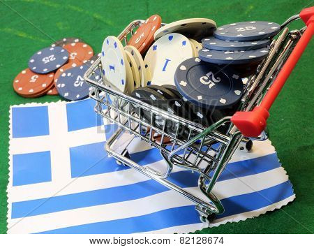 Shopping Cart Full Of Casino Chips Over The Flag Of Greece To Gamble
