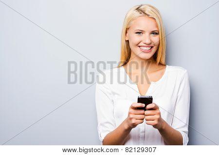 Examining Her Brand New Smart Phone.