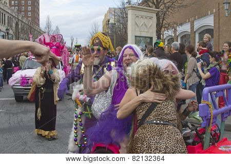 Laughter, Fun And Hugs In The Mardi Gras Parade