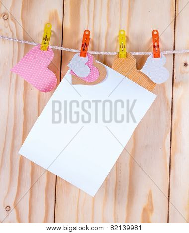 paper hang on clothesline with paper heart