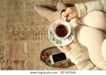 Top View Of Woman Holding Tea Cup