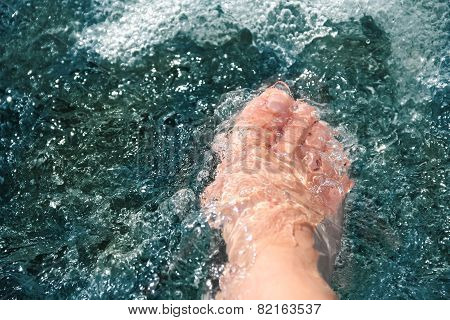 Women Foot, Refreshing And Hardening In A Mountain Brook