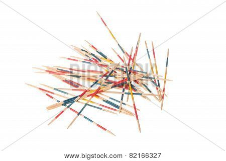 Lots Of Jackstraws Arranged On A White Background.