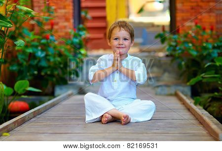 Cute Boy Trying To Find Inner Balance In Meditation
